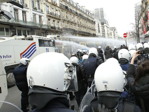 Police use water canon to try to disperse right wing demonstrators during a protest at the site of one of the memorials to the victims of the recent Brussels attacks on March, 27, 2016.