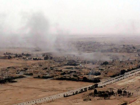 A handout photo made available by the official Syrian Arab News Agency (SANA) shows smoke rising over Palmyra, central Homs province, Syria, 26 March 2016. According to SANA, government forces, in cooperation with the popular defense groups, are cond