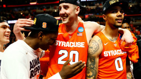 CHICAGO, IL - MARCH 27:  Tyler Lydon #20 and Michael Gbinije #0 of the Syracuse Orange celebrate their 68 to 62 win over the Virginia Cavaliers during the 2016 NCAA Men's Basketball Tournament Midwest Regional Final at United Center on March 27, 2016 in Chicago, Illinois.  (Photo by Jamie Squire/Getty Images)