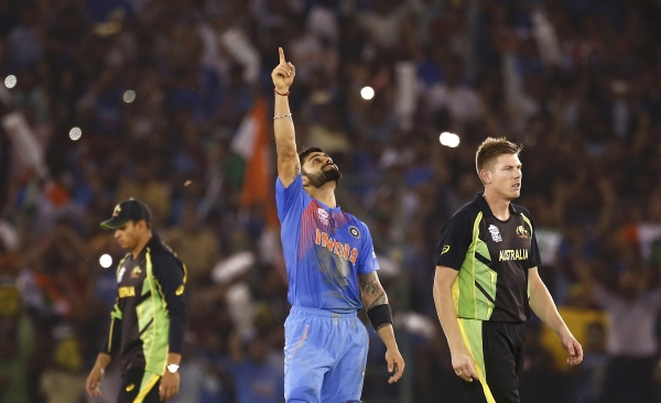 India's Virat Kohli, centre, celebrates after guiding his team to victory over Australia in the World T20 match in Mohali on Sunday. Photo - Reuters