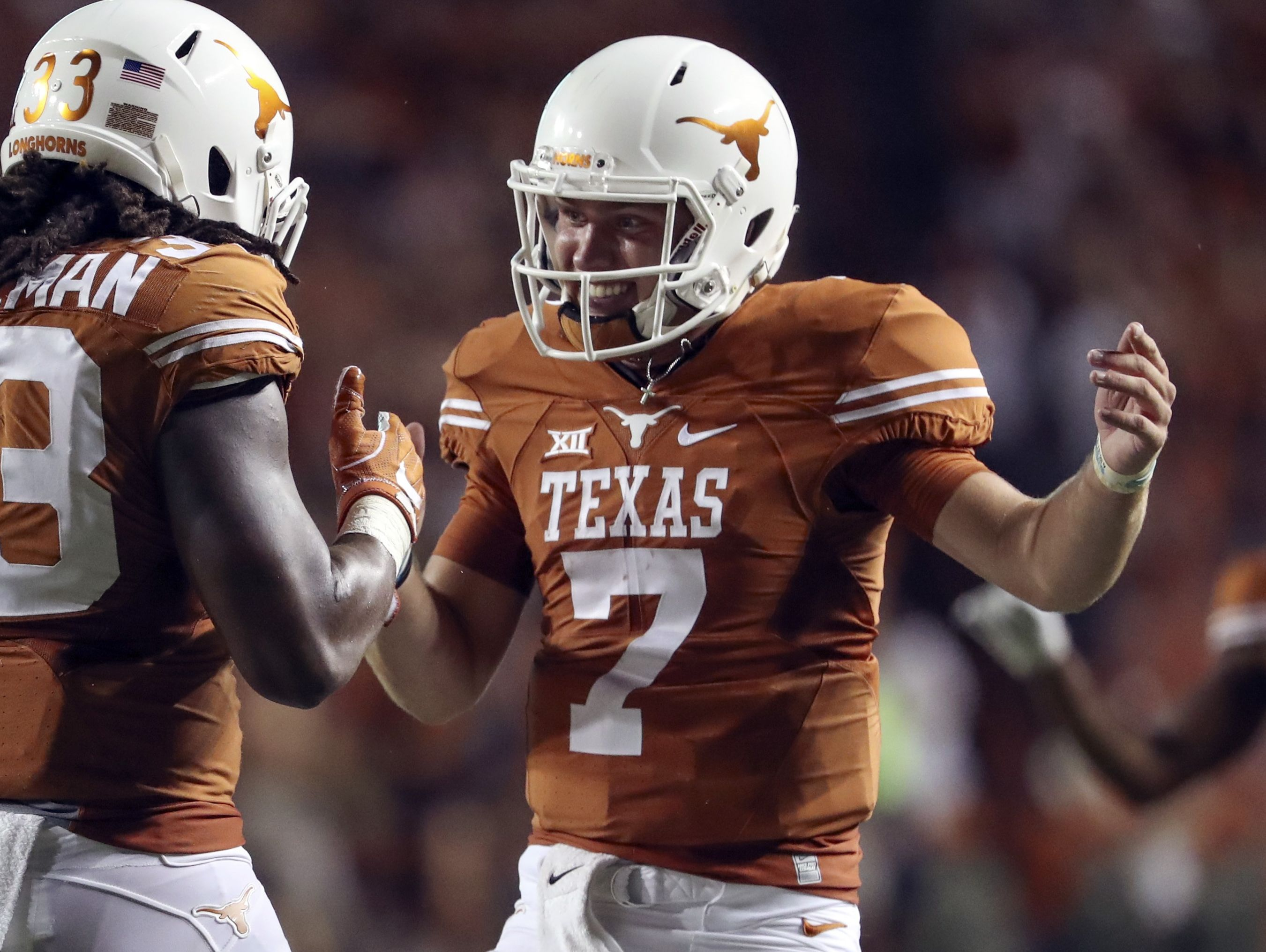 True freshman Shane Buechele threw for 280 yards and two TDs in Texas' wild season-opening win.