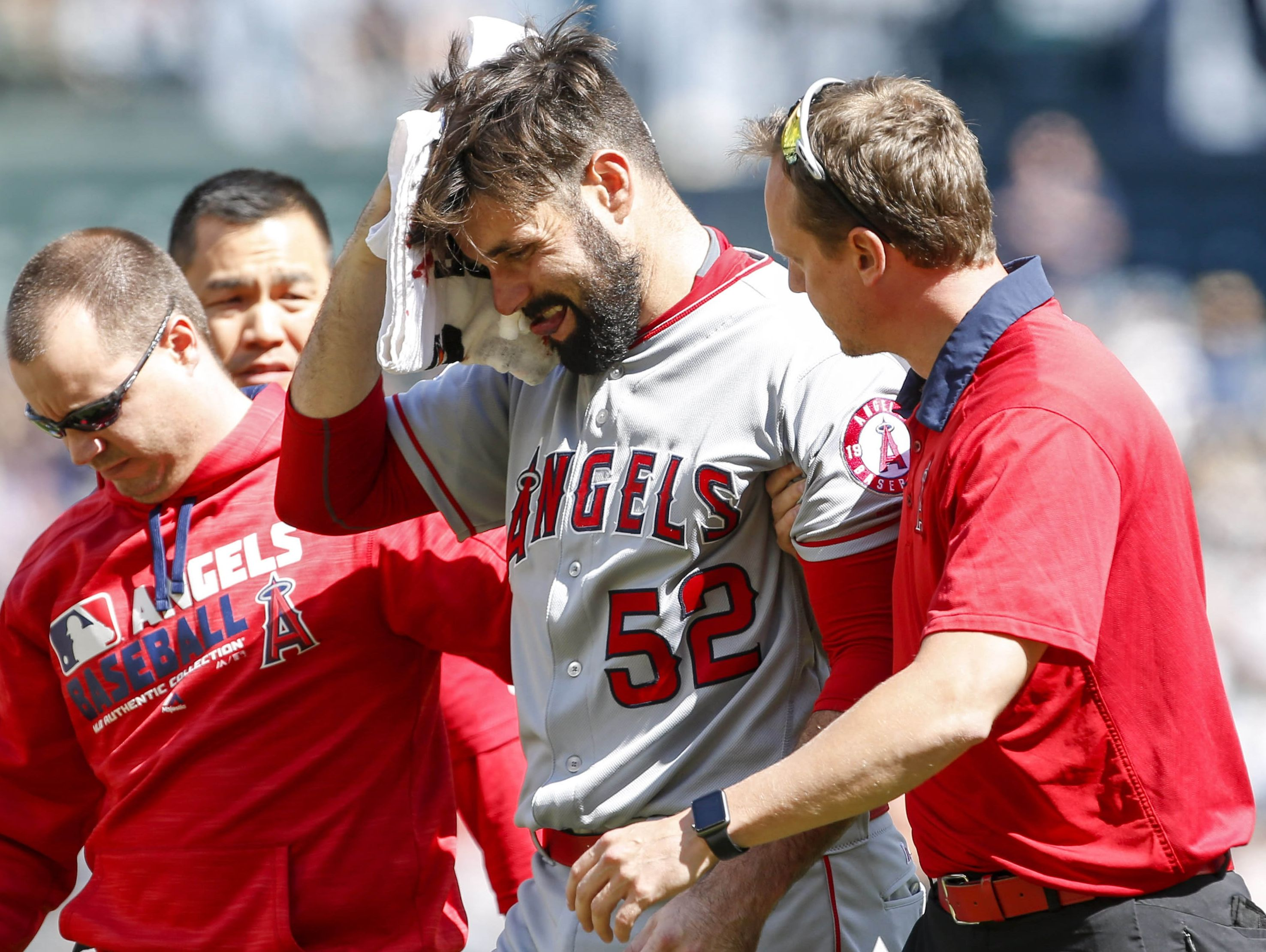 Matt Shoemaker leaves the field after being struck in the head by a line drive.