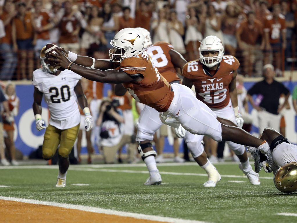 Texas quarterback Tyrone Swoopes (18) dives into the end zone for the game-winning touchdown in the second overtime against Notre Dame in Austin. Swoopes' score gave the Longhorns a 50-47 upset of the ninth-ranked Fighting Irish.