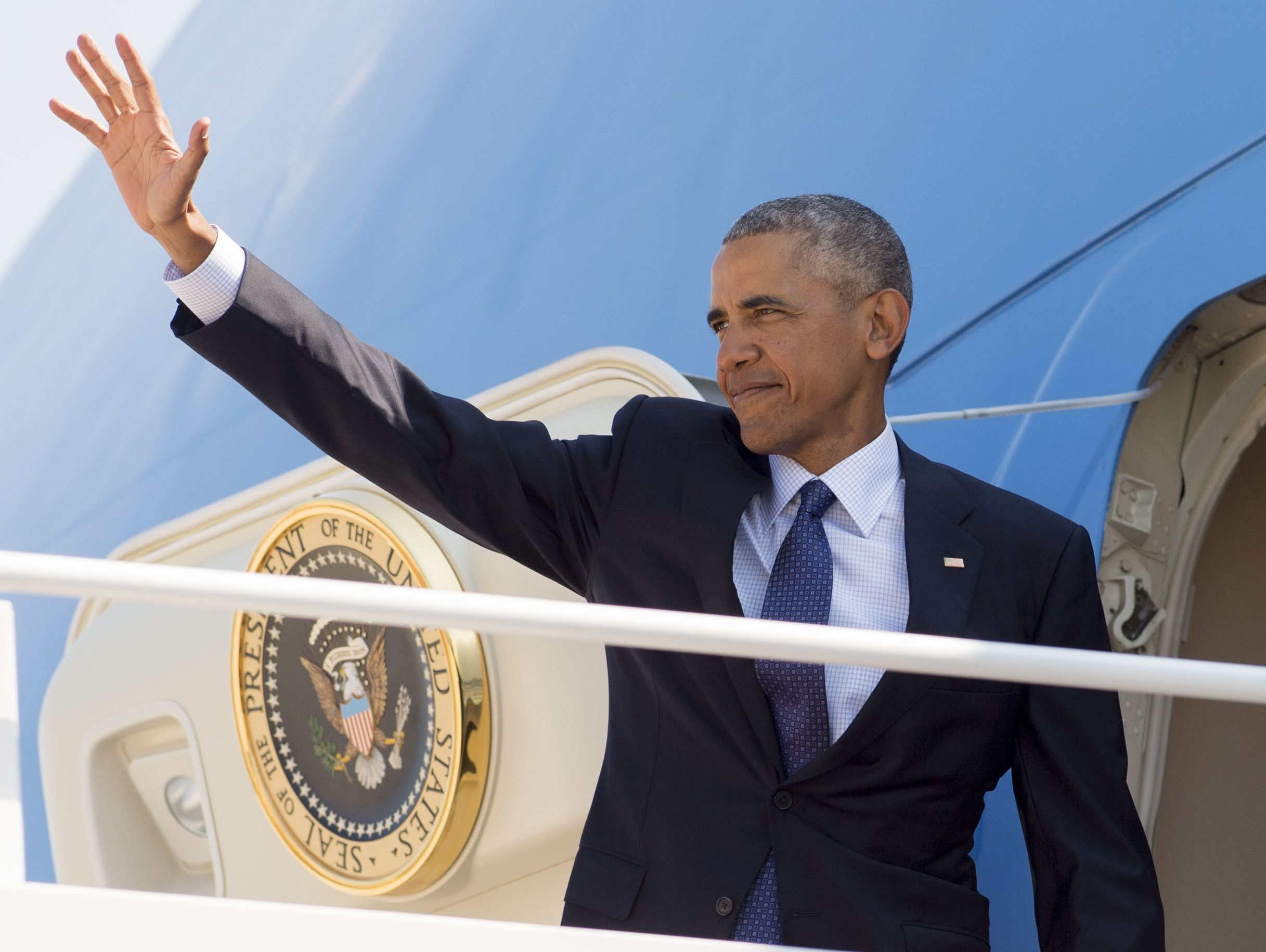 President Obama waves from Air Force One prior to departing from Andrews Air Force Base in Maryland, August 31, 2016, as he travels on a 9-day trip to Nevada, Hawaii, Midway Island, China and Laos.