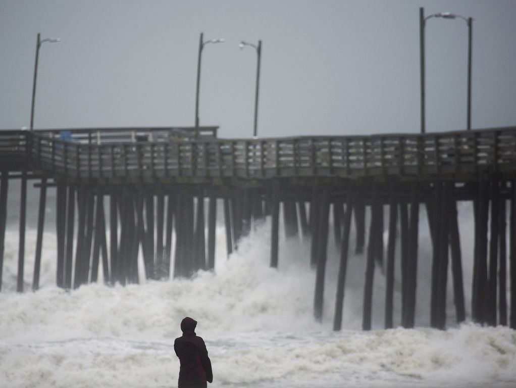 Lucille Rang, who is originally from Canada but moved to Virginia Beach, Va., recently, looks at the waves at a fishing pier in Virginia Beach as the remnants of Hermine head up the coast Sept. 3, 2016. Forecasters said the system could strengthen ba