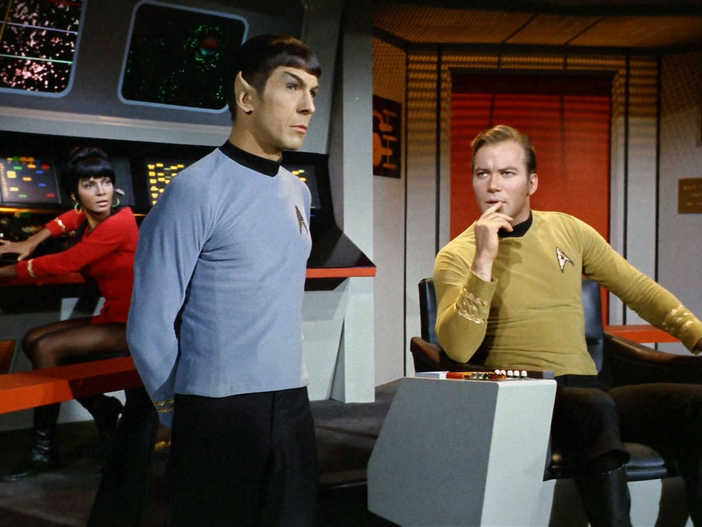 Nichelle Nichols as Lt. Uhura, Leonard Nimoy as Commander Spock (Mr. Spock) and William Shatner as Captain James T. Kirk on the bridge of the USS Enterprise on the Star Trek: The Original Series episode