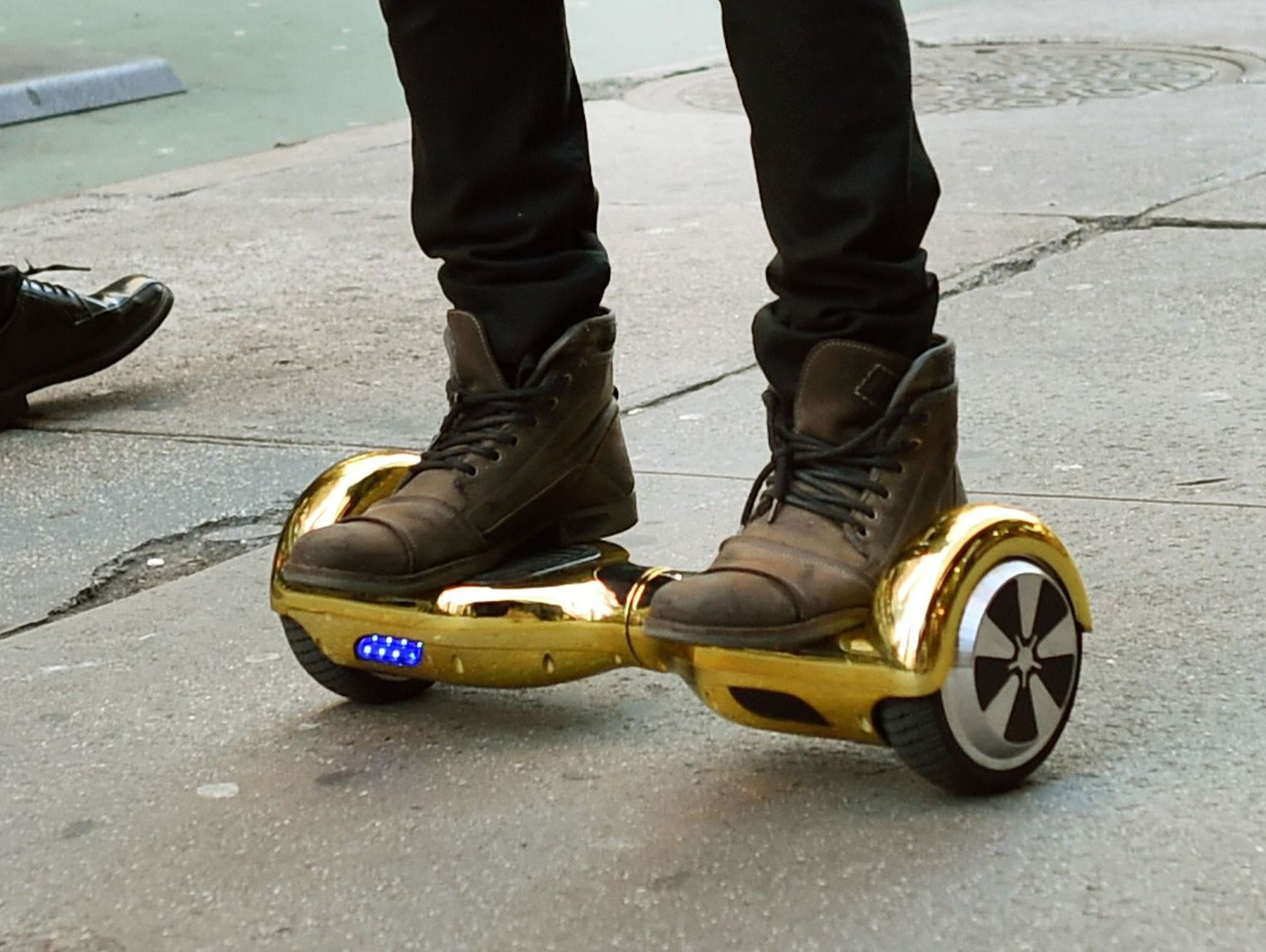 This file photo taken on December 15, 2015 shows  Whizboard Store manager 'Mor Loud'demonstrating the Hoverboard in New York. The United States announced on July 6, 2016, the recall of more than a half-million hoverboards after scores of incidents in