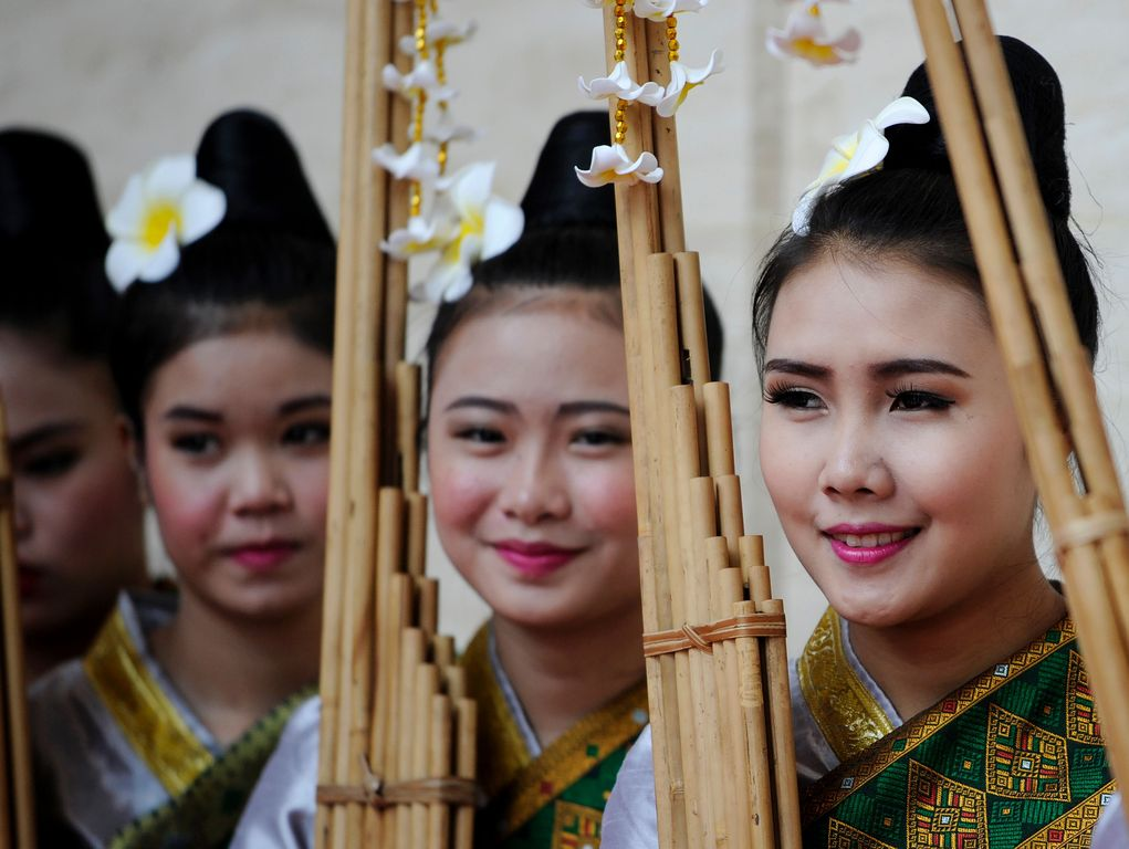 Performers rest after their rehearsal using the Khean instrument during the 28th Association of Southeast Asian Nations Summit at the National Convention Centre in Vientiane.