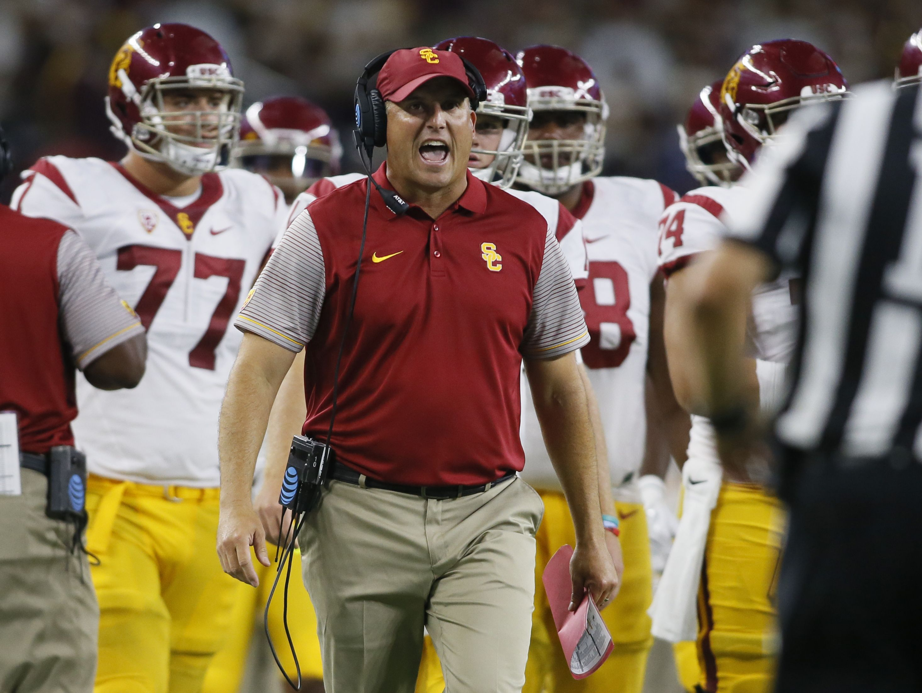 Coach Clay Helton and USC were blown out by Alabama in their opener.