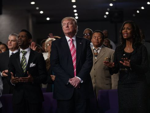 Donald Trump, center, lat church service at Great Faith Ministries, Detroit, Sept. 3, 2016.