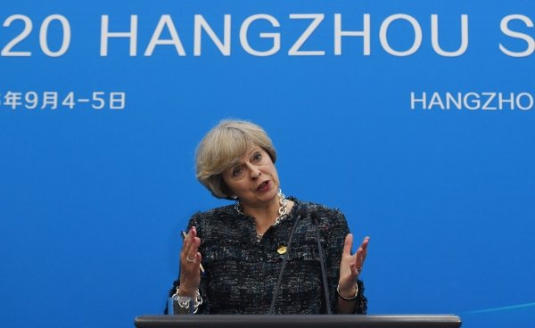 Britain's Prime Minister Theresa May speaks at a press conference after the closing of the G20 Leaders Summit in Hangzhou on September 5, 2016.  May sought September 5 to start shaping her country's post-EU access to world markets, but faced a Japanese warning over the fallout from Brexit while the US said London was not its priority. AFP