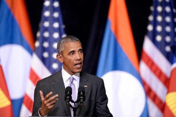 US President Barack Obama gestures as he delivers a speech about US-Laos relations at the Lao National Cultural Hall in Vientiane on September 6, 2016.- AFP